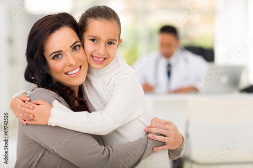 canvas print picture mother and daughter hugging in doctor's office