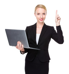 Caucasian businesswoman with notebook and finger up
