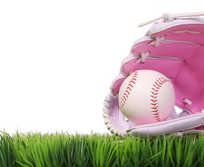 Baseball in Pink Female Glove on Green Grass, isolated on white.