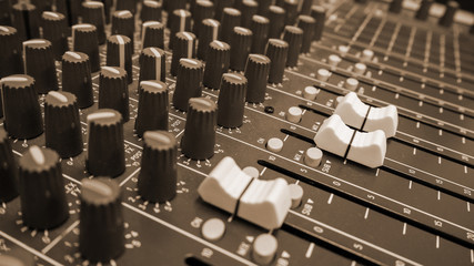 Close-up of music controls buttons of studio mixer