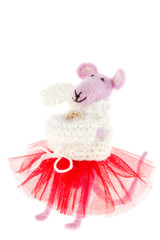 toy mouse in pink scarf and a red skirt