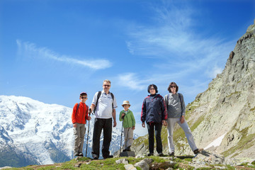 The family from five persons stays against massif of Mont Blanc