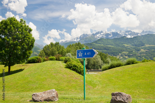 Poster The pointer of highway on roadside in european mountains