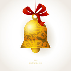 Golden Christmas bell with ribbons and place for text.