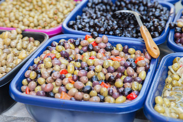Marinaded olives on market place counter