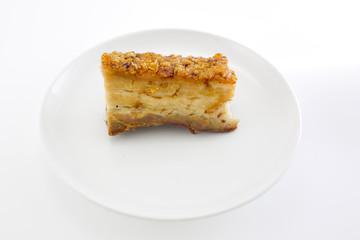 Freshly baked crispy pork belly on white background