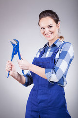 Plumber woman with wrench