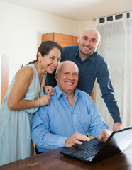 Two men and woman at home online