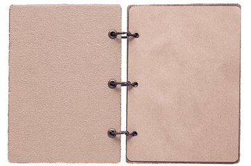 open notebook of brown terracotta color