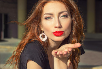 beautiful sexy girl with red hair with big red lips with makeup