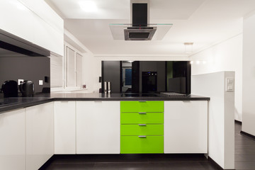Interior of black and white kitchen