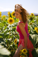 Young woman in sunflowers