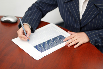 Office worker fill form in office