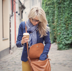 Woman searching for stuff in her handbag