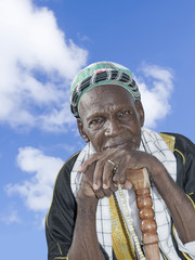 Old African man wearing traditional clothing