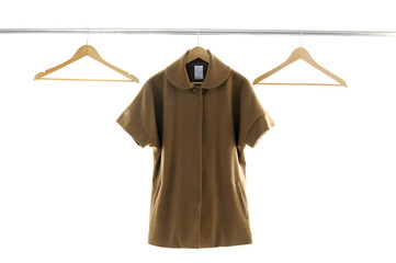 Display of female coat and bag
