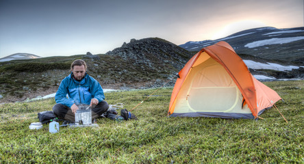 cooking in front of the tent in the evening