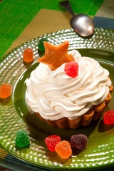 cake with cream and jelly on green plate