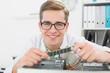 Smiling technician working on broken cpu
