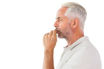 Man staying silent with finger on lips
