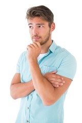 Handsome young man thinking with hand on chin