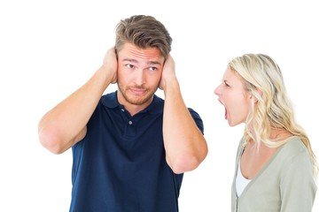 Man not listening to his shouting girlfriend