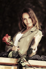 Portrait of happy young fashion woman with a rose