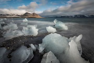 Glacier ice on the Arctic beach - landscape