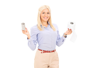 Woman holding two rolls of toilet paper