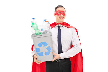 Superhero holding a recycle bin
