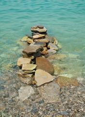 balanced stones on the sea
