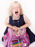Cute child with school bag crying out loud