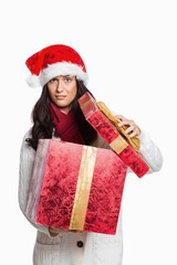 Confused woman opening christmas present