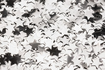 Many silver star decorations background