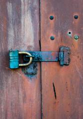 Padlock and metal door