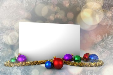 Composite image of poster with baubles