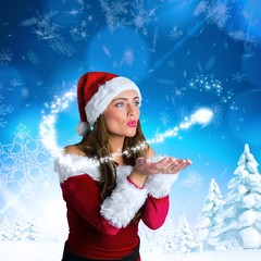 Composite image of pretty girl in santa costume holding hand out