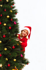 child in a christmas red dress peeking out from behind the Chris