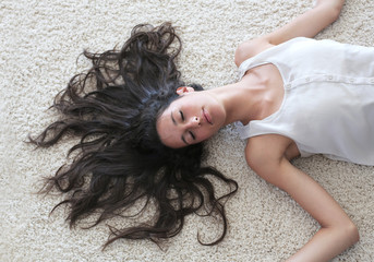 beautiful woman who is sleeping on the floor