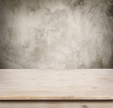 Fototapety Wooden table on defocuced vintage wall background
