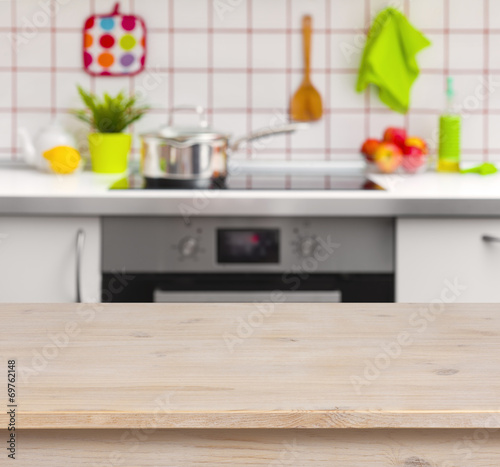Wooden table on blurred kitchen bench background - 69762148