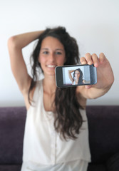 young girl who is taking a photo of herself