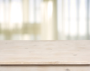 Wooden table on defocuced window with curtain background