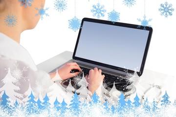 Composite image of businesswoman running computer diagnostics