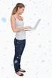 Composite image of portrait of a woman using a laptop