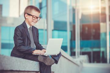 kid businessman with laptop