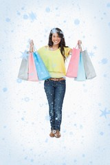 Composite image of beaming woman student with shopping bags