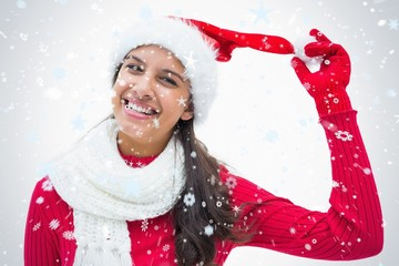 Composite image of beautiful festive woman smiling at camera