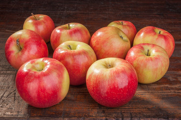 red apples on the old table