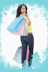 Beautiful woman student with shopping bags